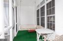 Screened porch with swing - 6421 ROBINSON RD, SPOTSYLVANIA