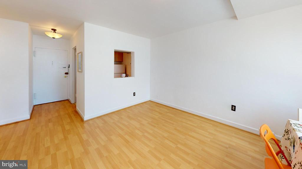 New wood laminate flooring carries throughout - 1121 ARLINGTON BLVD #509, ARLINGTON