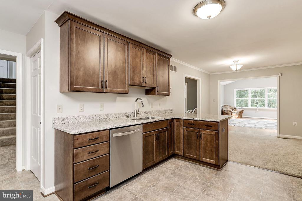 Gourmet Kitchen with Maple Cabinetry | Dining Room - 8015 DUSTIN DR, FREDERICK