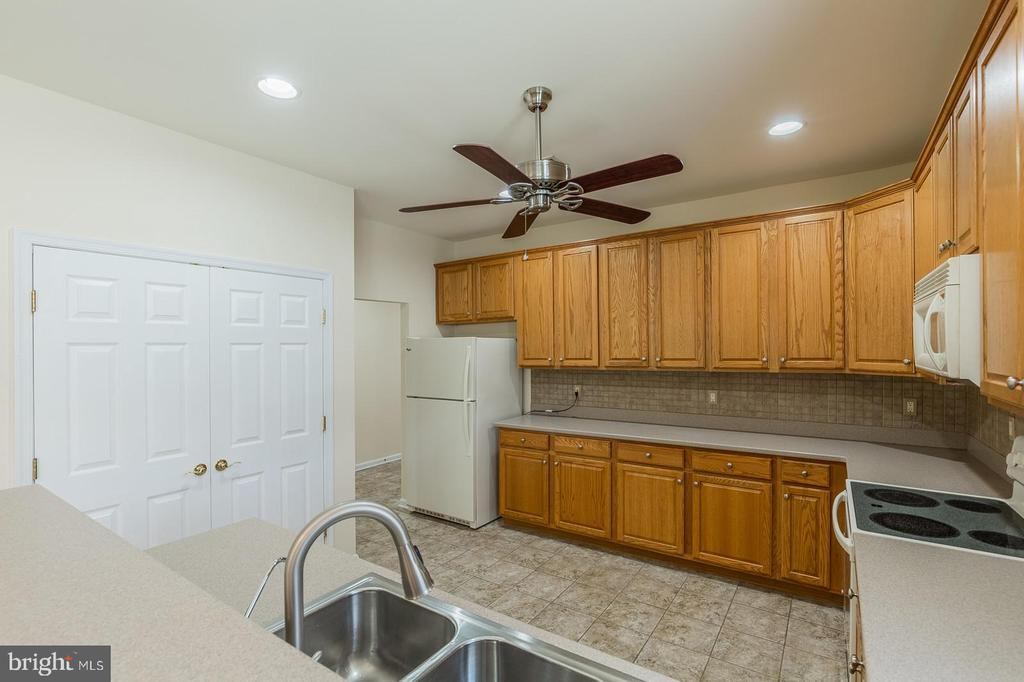 Kitchen with Lots of Cabinets & Large Pantry - 17416 CELEBRATION WAY, DUMFRIES