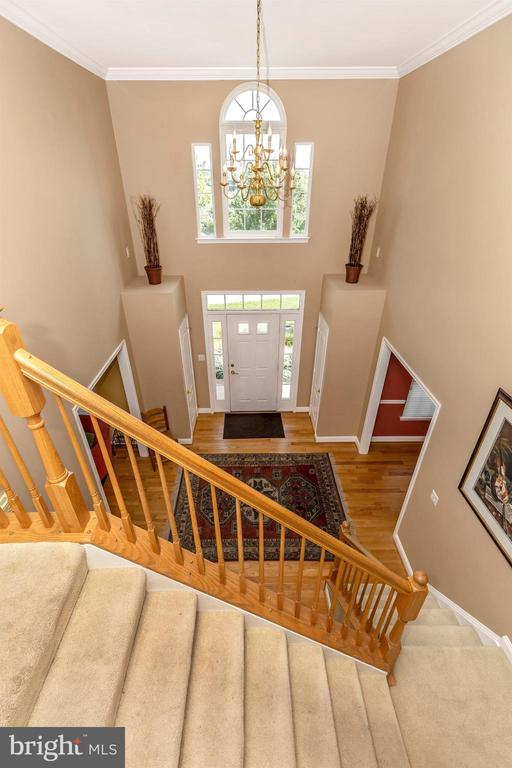 High ceilings in the foyer with overlook staircase - 4126 LARSON LN, MOUNT AIRY