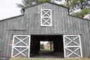 Center Isle Barn with 7 stalls, hayloft, tack room - 36180 TURKEY ROOST RD, MIDDLEBURG