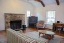 Family room with stone fireplace - 36180 TURKEY ROOST RD, MIDDLEBURG