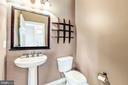 Powder room on main level - 25288 MCINTYRE SQ, CHANTILLY
