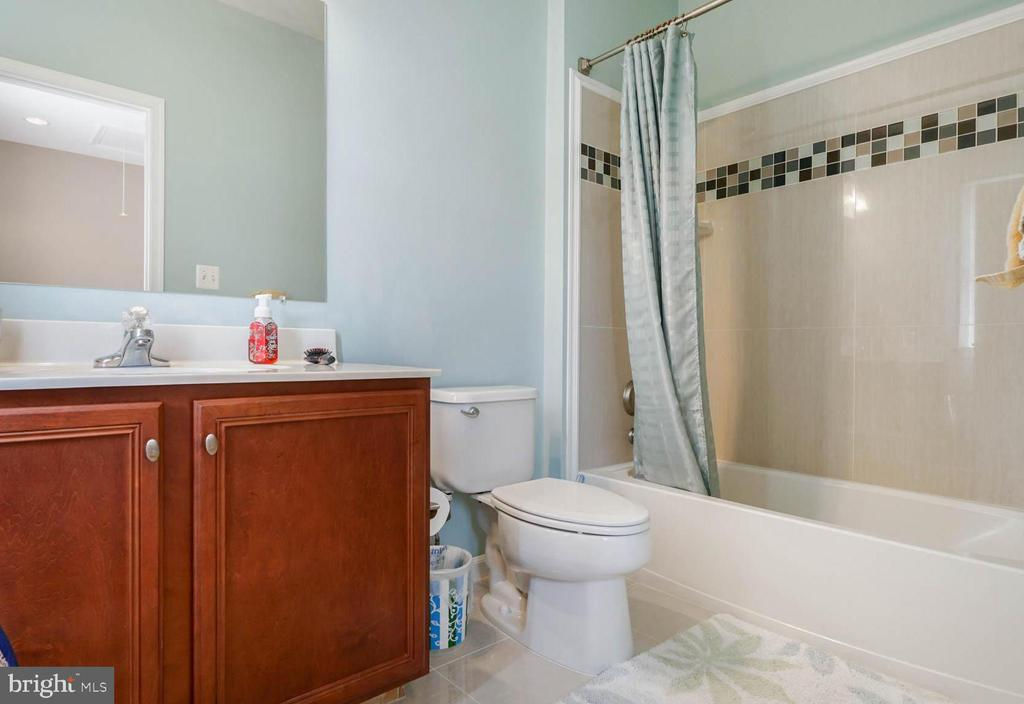 Bathroom with nice tiles and cabinet - 42531 LONGACRE DR, CHANTILLY