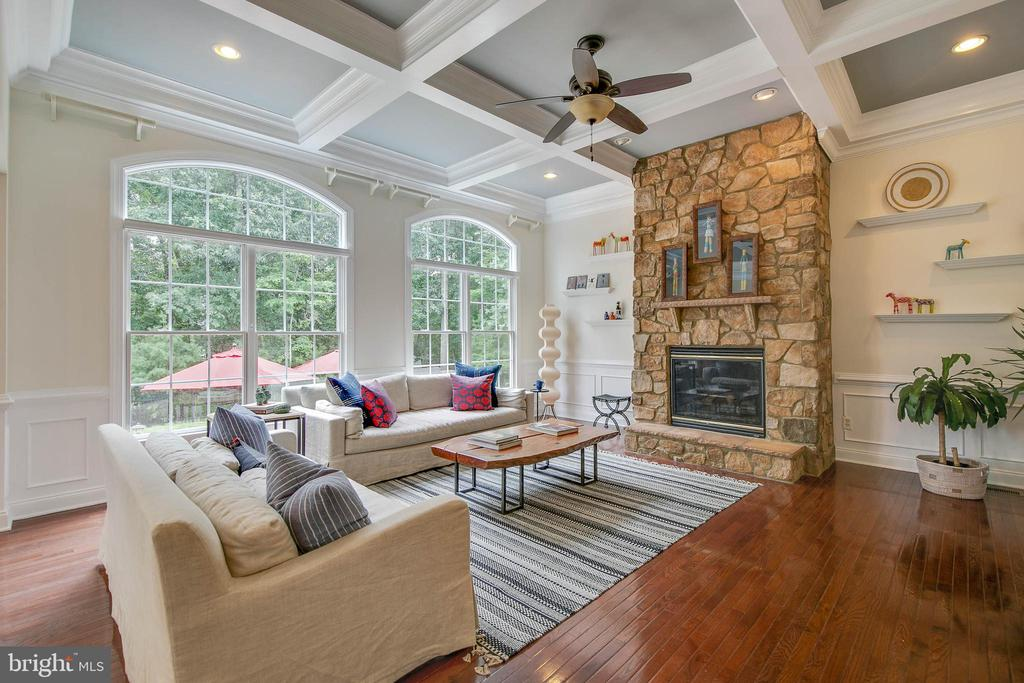 Family Room - Stone fireplace + coffered ceiling - 43353 VESTALS PL, LEESBURG