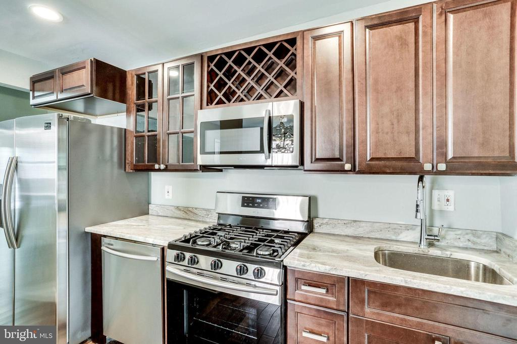 Kitchen with new stainless steel appliances - 277 NEWCOMB ST SE, WASHINGTON