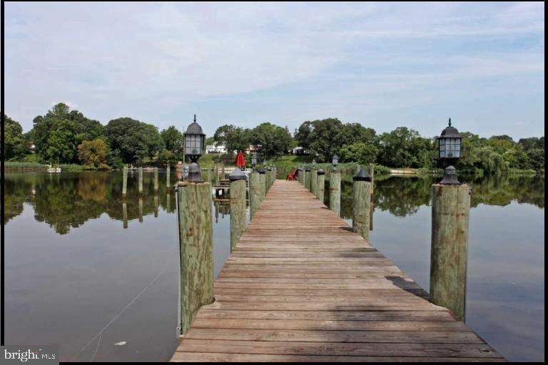 sturdy pier has a boat dock and a party deck - 504 CREEK CROSSING LN, GLEN BURNIE