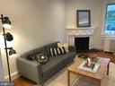 View: dining into front room, working fireplace - 1759 HOBART ST NW, WASHINGTON