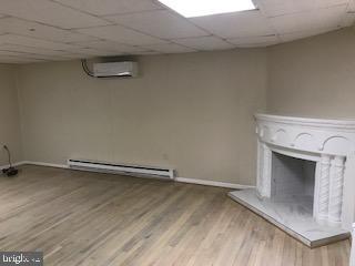 Lower level hardwood floors, fireplace - 1759 HOBART ST NW, WASHINGTON