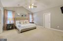 Master bedroom with cathedral ceiling! - 75 TOM JENKINS RD, FREDERICKSBURG