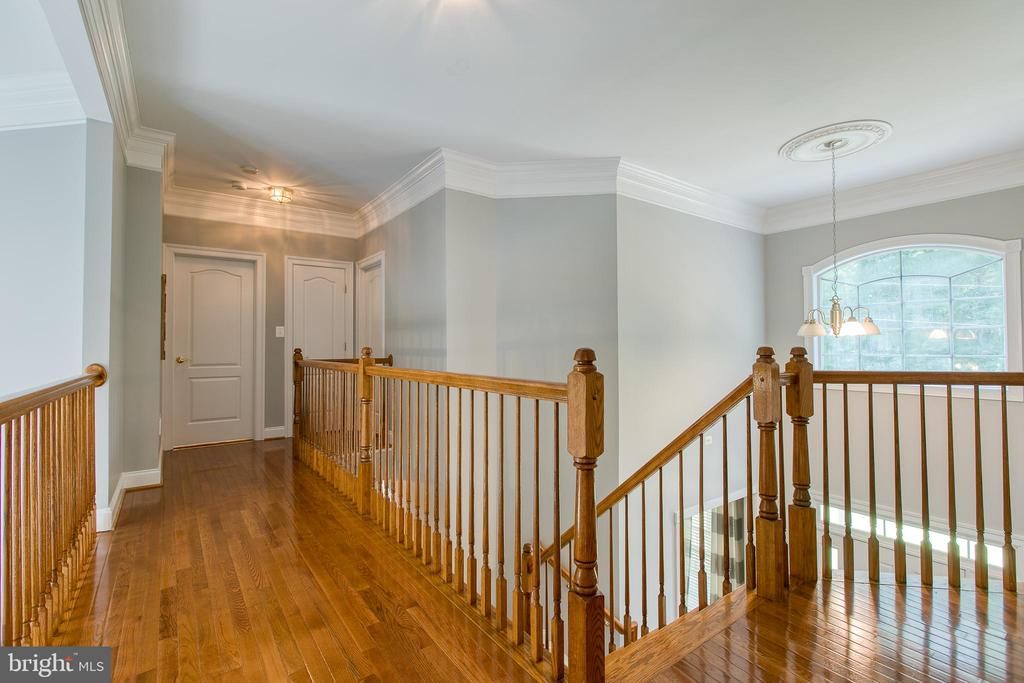 Wood flooring continues up the stairs to hall way - 75 TOM JENKINS RD, FREDERICKSBURG