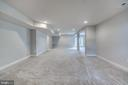 Finished basement with bar rough-in - 17266 HARMONY VISTA DR, HAMILTON