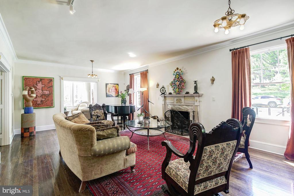 Living room with wood burning fireplace - 2733 35TH ST NW, WASHINGTON