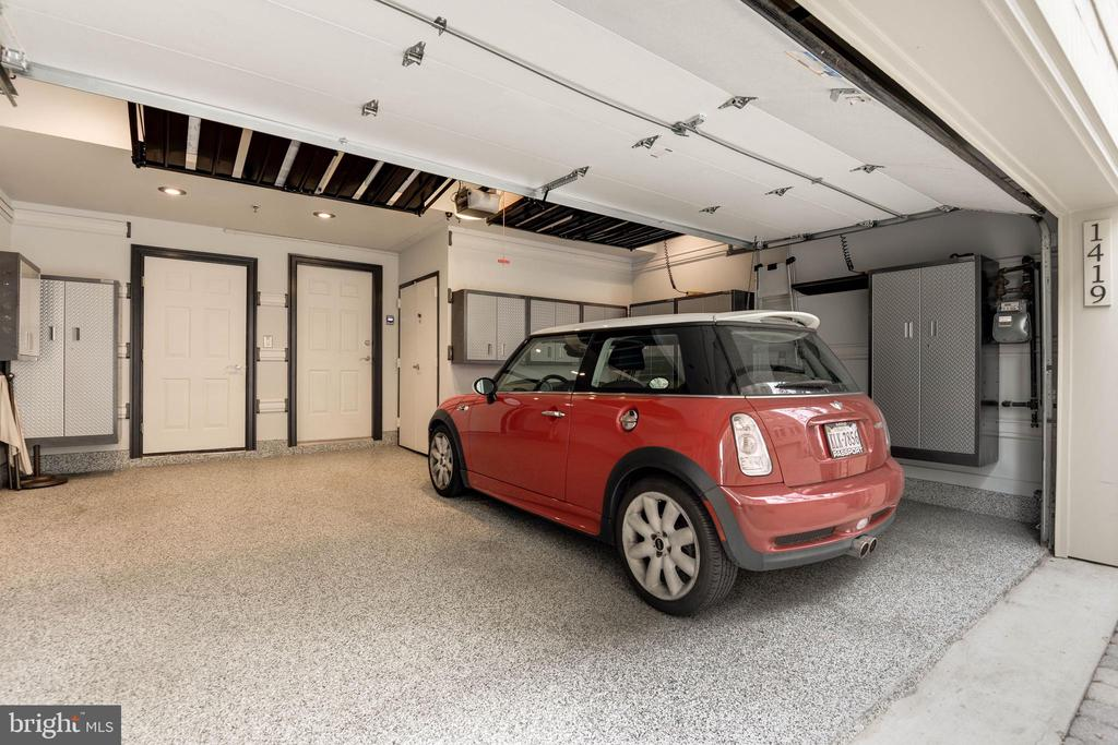 Large two car garage with a lot of storage space! - 1419 N NASH ST, ARLINGTON