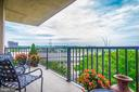 Wrap-around balcony in the living room! - 1300 ARMY NAVY DR #1009, ARLINGTON
