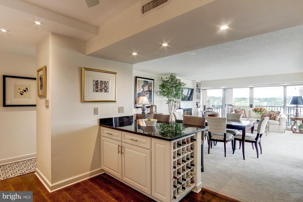 Extra wine storage. Kitchen opens to living space - 1300 ARMY NAVY DR #1009, ARLINGTON