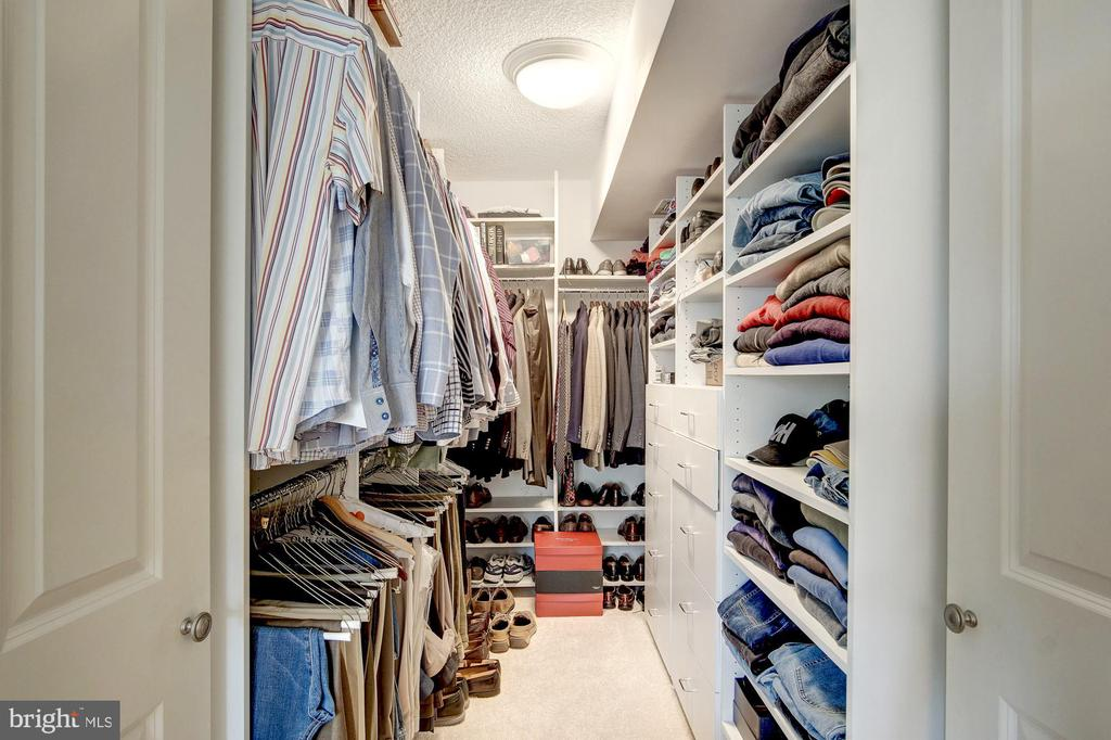 Custom walk-in closet in the owner's suite - 1300 ARMY NAVY DR #1009, ARLINGTON