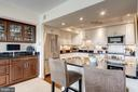 Kitchen breakfast bar + built-in serving area (L) - 1300 ARMY NAVY DR #1009, ARLINGTON
