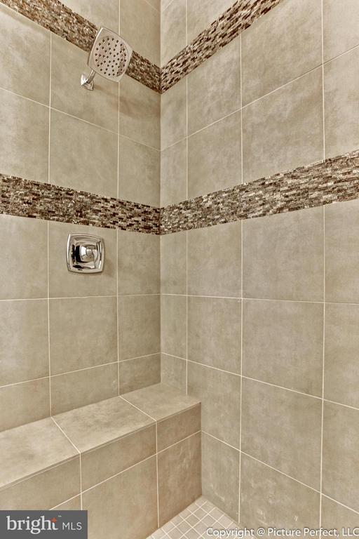 Luxury tile in the master shower - 6795 ACCIPITER DR, NEW MARKET