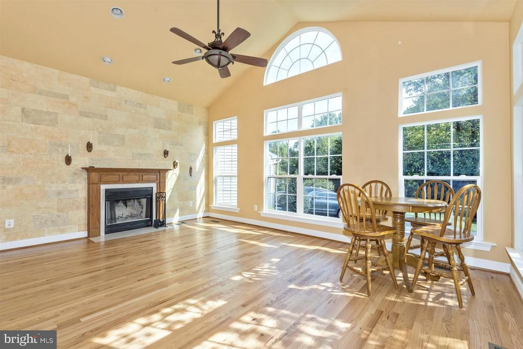 Tons of natural light and a cozy fireplace - 6830 WOODCREST RD, NEW MARKET