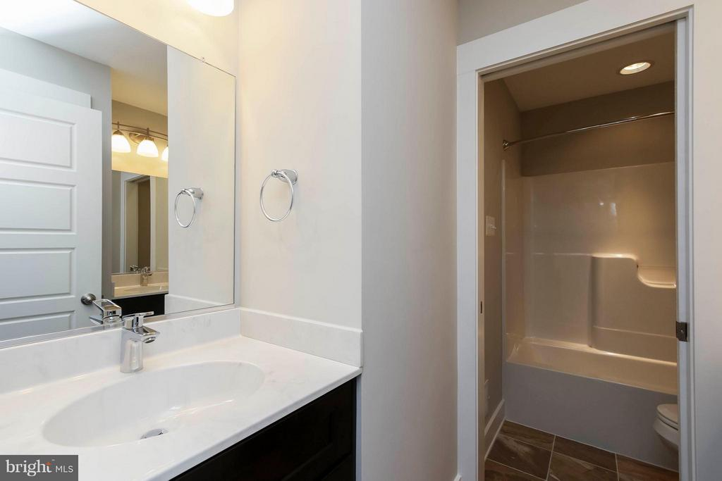 Hall bathroom with privacy tub / toilet - 4736 OLD MIDDLETOWN RD, JEFFERSON