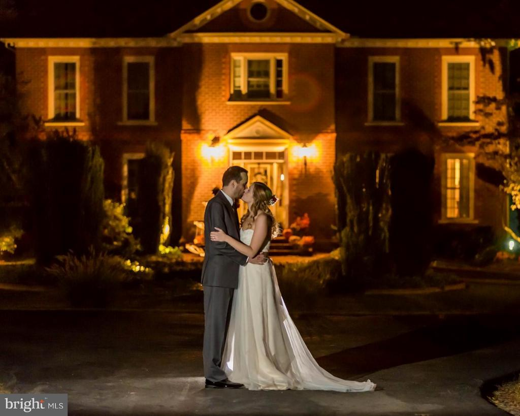 Bride and Groom at Dusk in Front of Main Residence - 6818 RIVER RD, FREDERICKSBURG