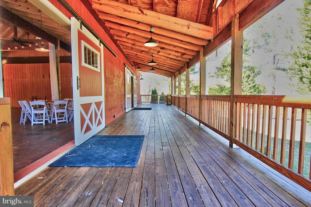 Spacious Covered Side Porch of Events Barn - 6818 RIVER RD, FREDERICKSBURG