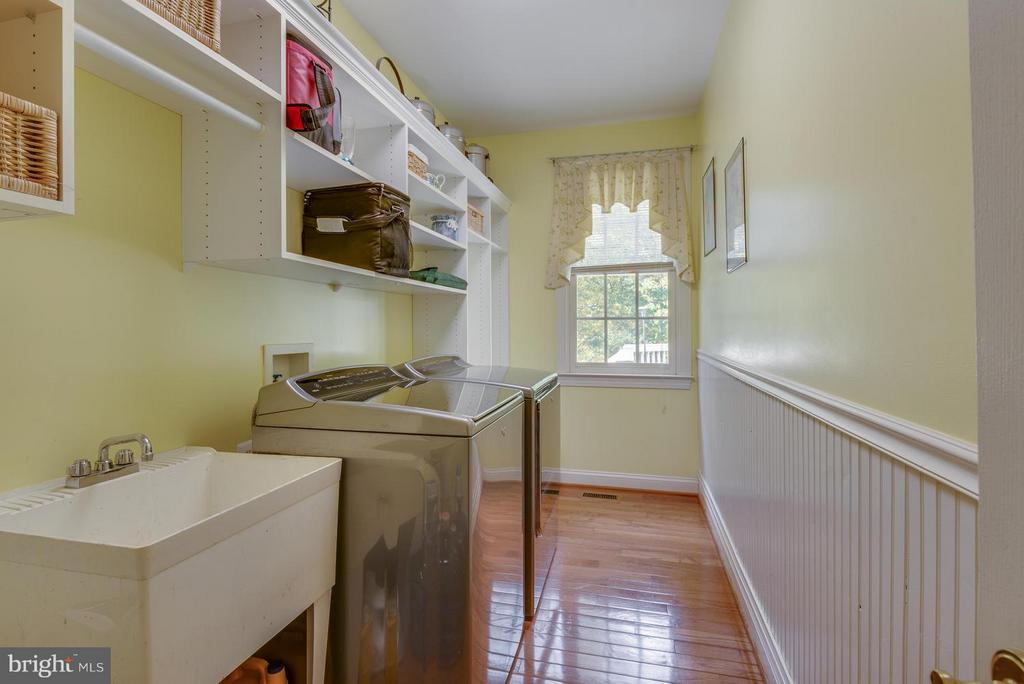 Main level laundry with custom cabinetry - 12100 WALNUT BRANCH RD, RESTON