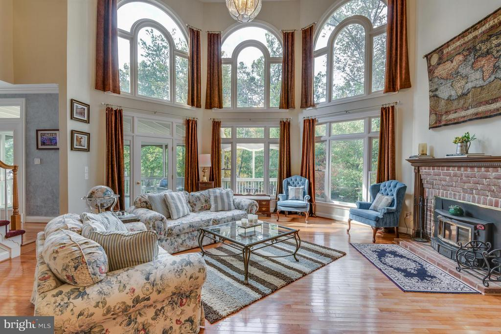 Two story cathedral ceiling, woodburning fireplace - 12100 WALNUT BRANCH RD, RESTON