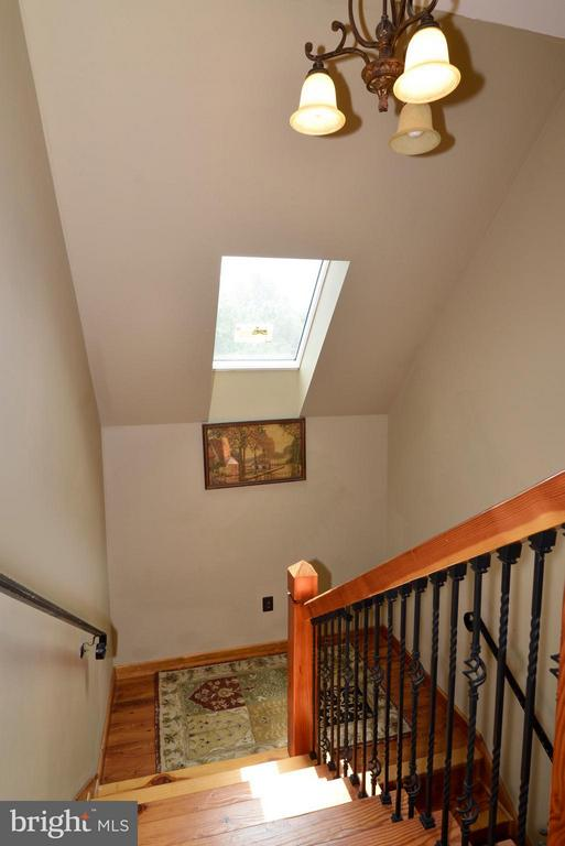 Wood Stairwell with detailed Iron rails - 34894 PAXSON RD, ROUND HILL