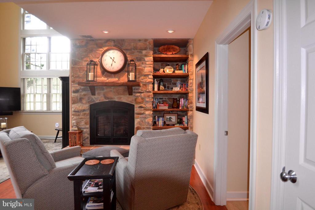 Stone fireplace,with hand-hewn barn wood mantle - 13878 POND VIEW LN, MERCERSBURG