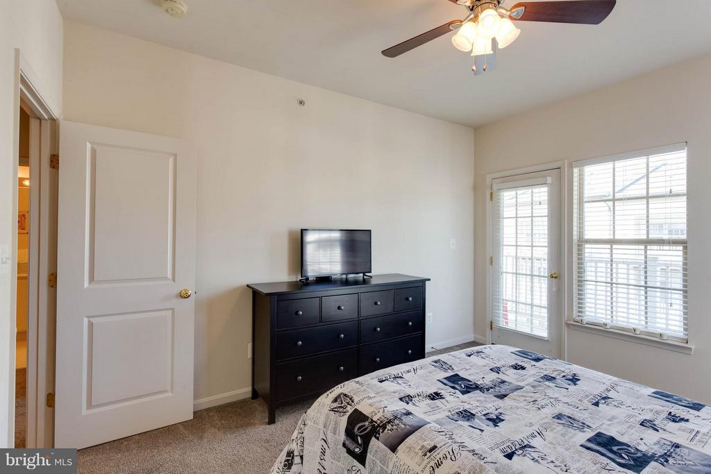 Secondary Bedroom with Private Balcony - 7957 CRESCENT PARK DR, GAINESVILLE