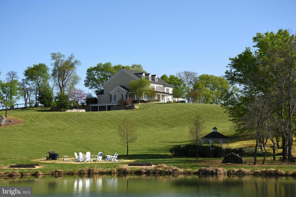 View Across Pond to West Elevation - 96 LYLE LN, AMISSVILLE