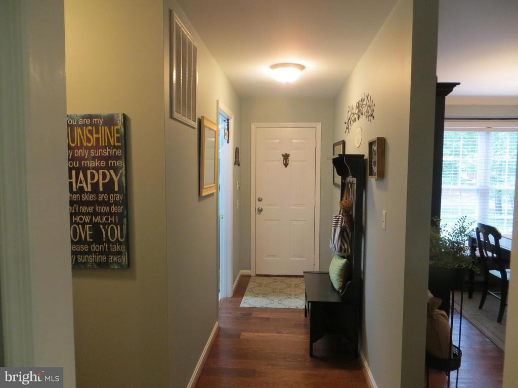 Hallway to laundry & garage - 119 PATRICK HENRY CT, LOCUST GROVE