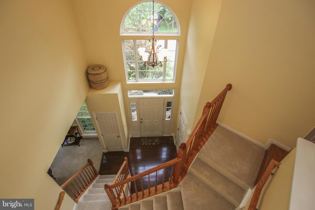 New carpet on stairs leading to 2nd level - 1235 FEATHERSTONE LN NE, LEESBURG