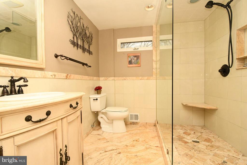 Marble shower walls & flooring/frameless glass - 10516 ARROWOOD ST, FAIRFAX