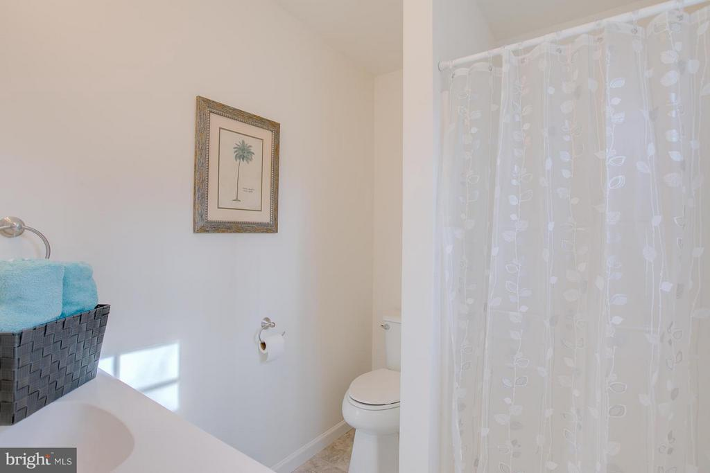 Updated bathroom with new tile floor. - 112 COAL LANDING RD, STAFFORD