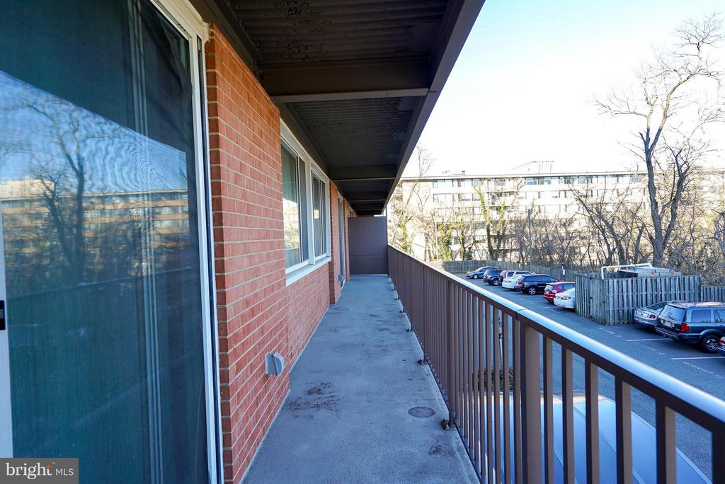 Balcony w/ entrances from living and master bed - 4343 LEE HWY #203, ARLINGTON
