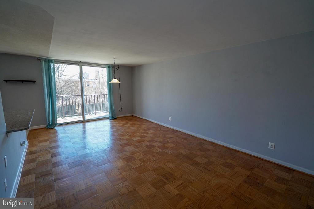 Dining room leads out to massive balcony - 4343 LEE HWY #203, ARLINGTON