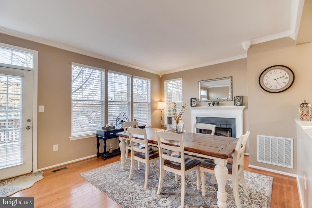 Dining Room w/ Gas Fireplace; Opens to Large Deck - 5099 HIGGINS DR, DUMFRIES