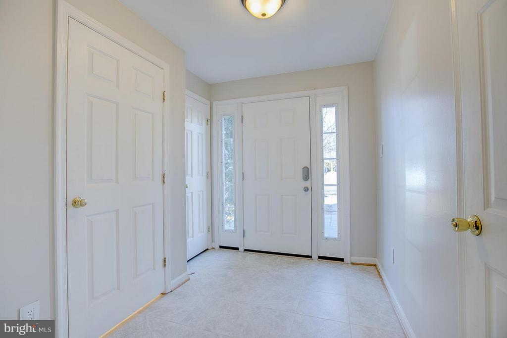 Entry way, door to garage, 1/2 bath, closet - 4540 PAPILLION CT, FREDERICKSBURG
