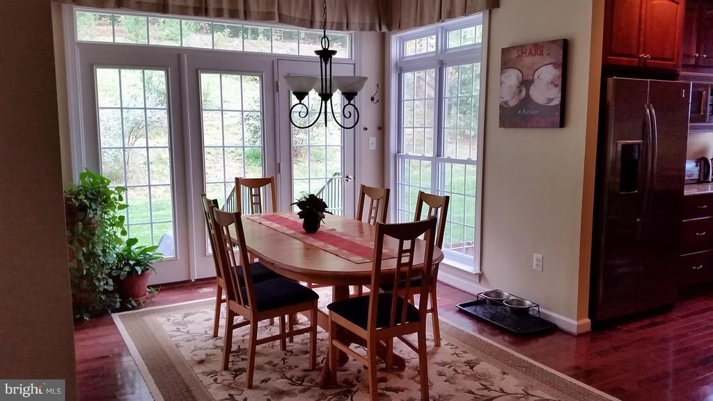 Dining Room Hardwood floor main level - 3609 STONEWALL MANOR DR, TRIANGLE