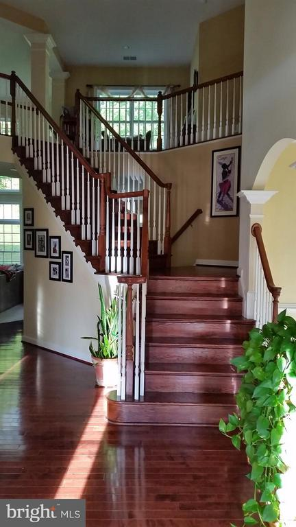 Two staircases to upper floor - 3609 STONEWALL MANOR DR, TRIANGLE