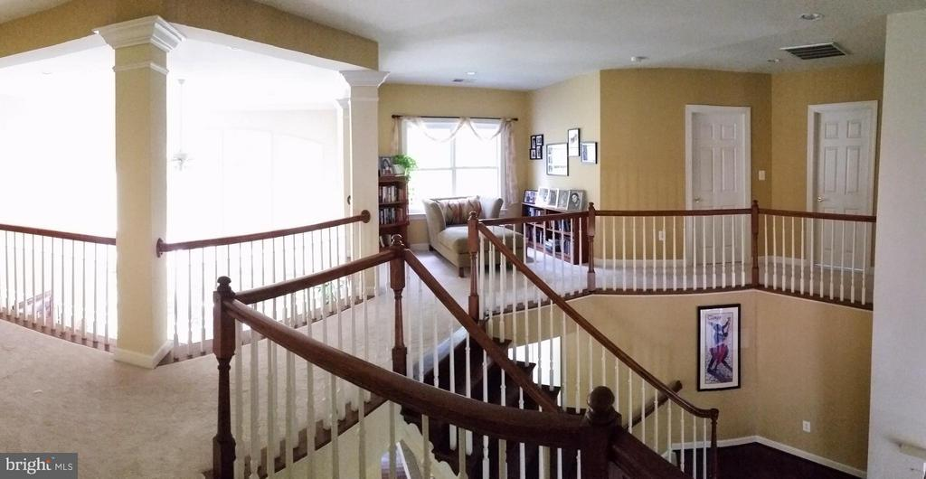Overlook to great room and entry - 3609 STONEWALL MANOR DR, TRIANGLE