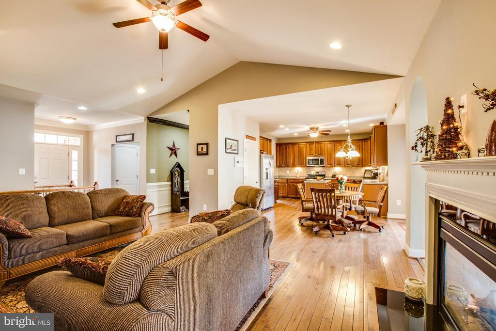 Family Room with double sided gas fireplace - 35115 SOMERSET RIDGE RD, LOCUST GROVE