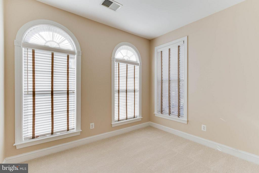 Second bedroom.  Notice the arched windows - 131 FORTNIGHTLY BLVD, HERNDON
