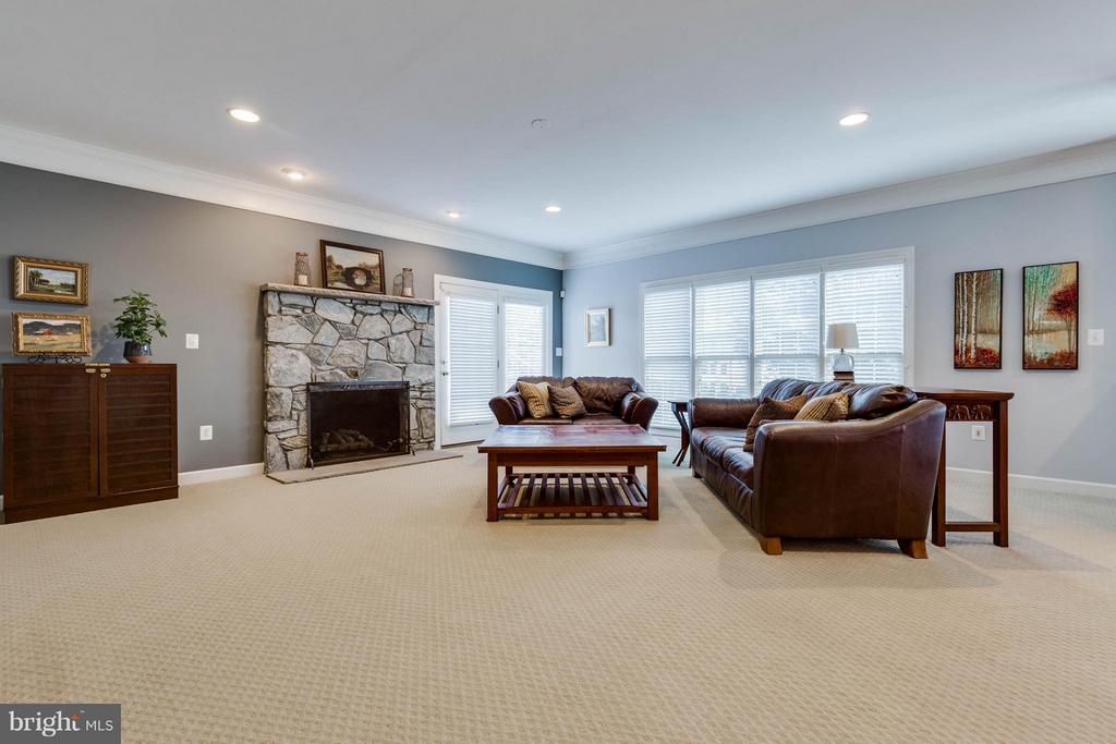 Spacious Family Room with Stone Gas Fireplace - 22752 PORTICO PL, ASHBURN