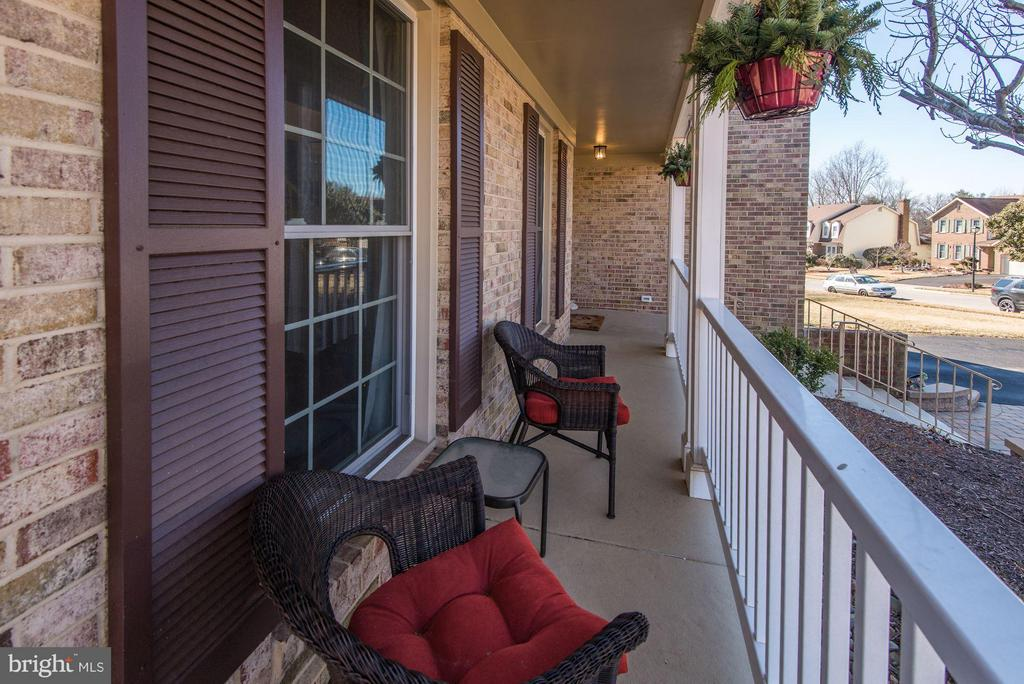 TIME TO RELAX ON YOUR CHARMING COVERED FRONT PORCH - 12418 WENDELL HOLMES RD, HERNDON