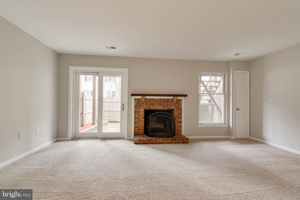 Basement Family Room wood burning fireplace - 11755 CRITTON CIR, WOODBRIDGE